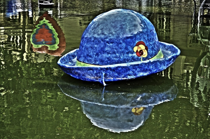 A Giant Hat And The Reflection Of A Heart
