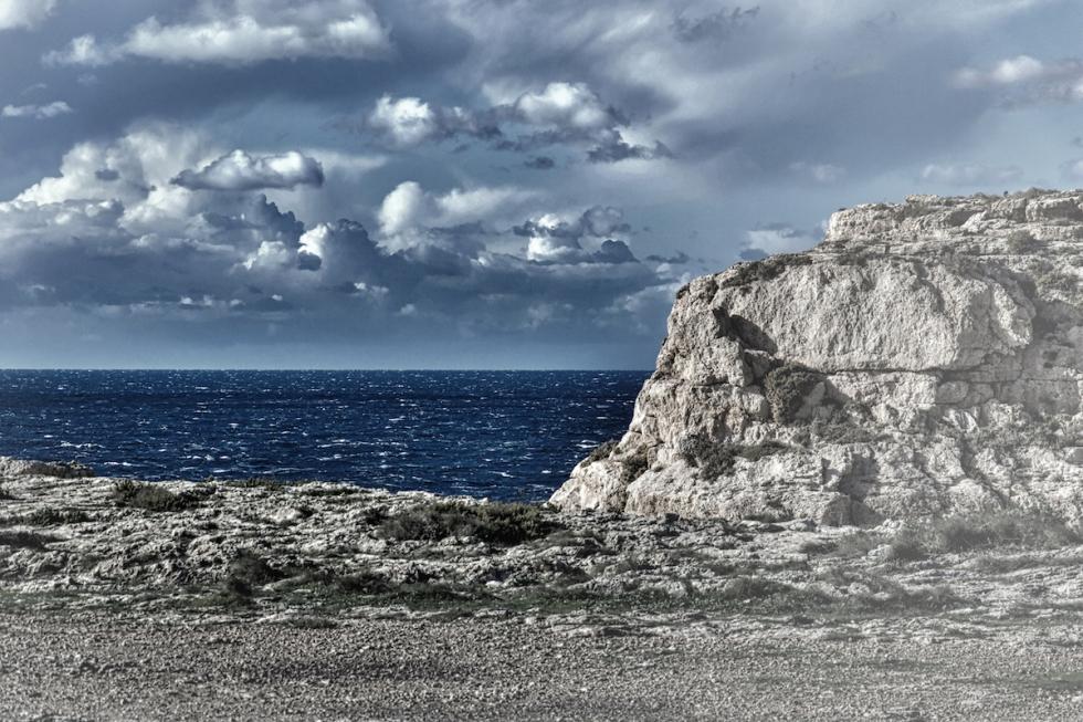 Behind The Cliffs The Deep Blue Sea