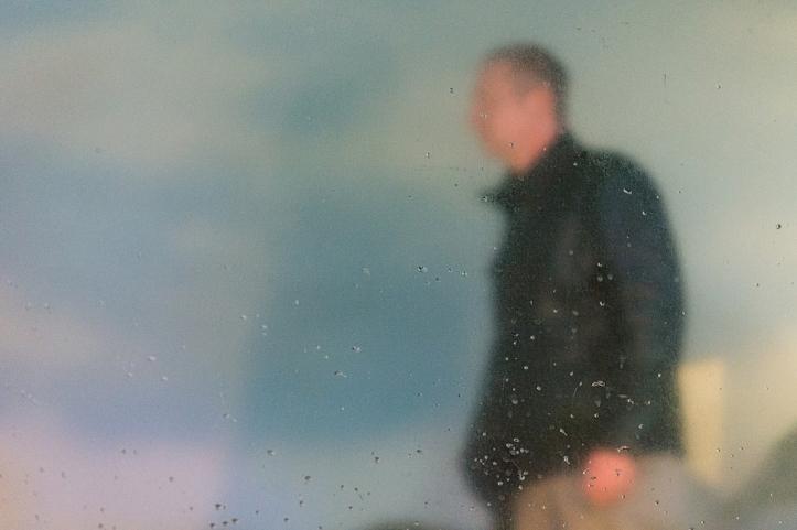 Man Behind Glass